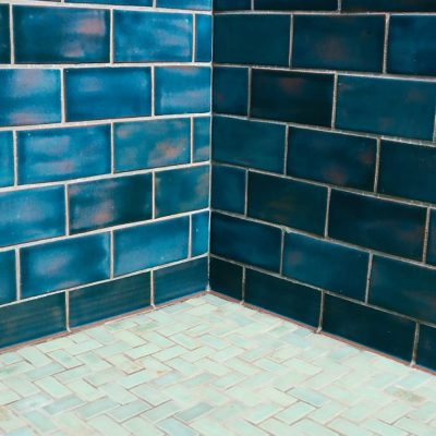 bathroom subway tile blue gem herringbone pattern