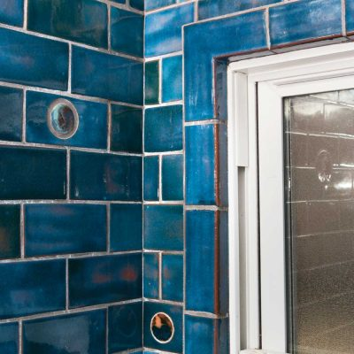 bathroom subway tile blue gem window